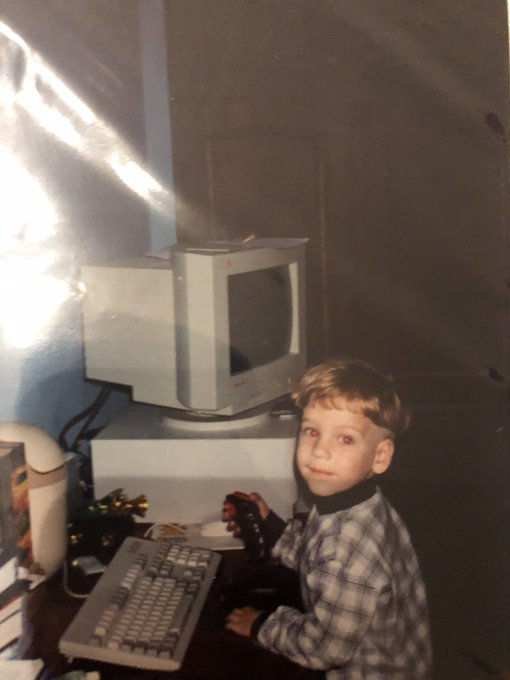 Myself as a child, playing DooM on a computer.
